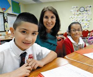 Yasmin Bhatia, Uplift Education CEO, with Uplift scholars